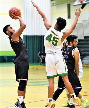 Notre Dame Royals graduate, standout athlete Peter Cruz is shown taking a shot in a high school game this past school year. Cruz signed with the UOG Tritons to play basketball.