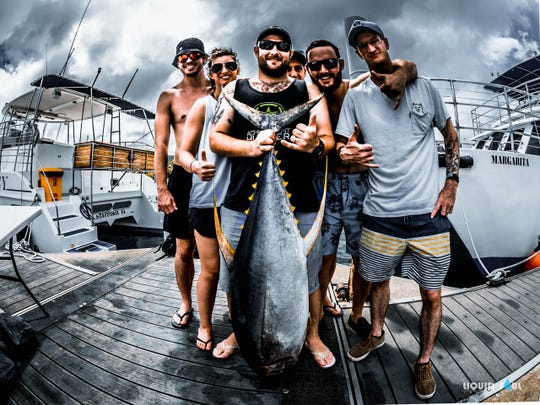 This guest crew of U.S. Military service members landed this 74.2 pound yellowfin tuna after a 20-minute fight above the boat No Quarter, operated by Rockstar Charters and captained by Barnaby Acfalle, on May 29, outside the southern bank of 11-Mile Reef.
