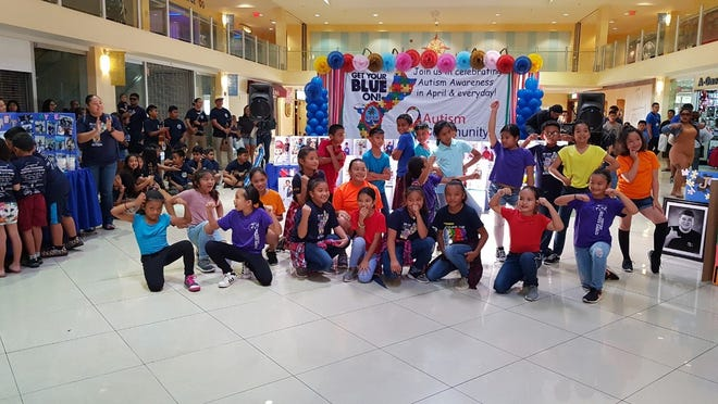 The Gate Dance Program, under the Direction of C'zer Medina, showed their support for the Autism Community Together on April 7 at Agana Shopping Center to celebrate ACT awareness month. The GATE top 10 dancers from Maria Ulloa, Liguan, Tamuning, Agana Heights, and Truman Elementary School. Not shown: Josephine Blas (ACT director).