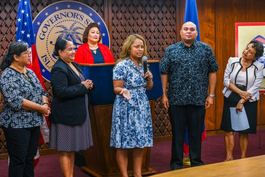 Paula Monk, center, United Airlines director of sales, announces that the company plans to offer discounted airfares, to Guamanians planning to return to home to celebrate the 75th Guam Liberation festivities, during a press conference at Adelup on Thursday, May 30, 2019. The event was held to announce the sponsors of this year's festivities.