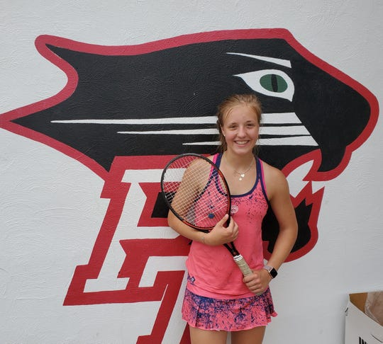 Park Tudor sophomore and foreign exchange student Jule Schulte poses in front of a Panthers logo on May 29, 2019.