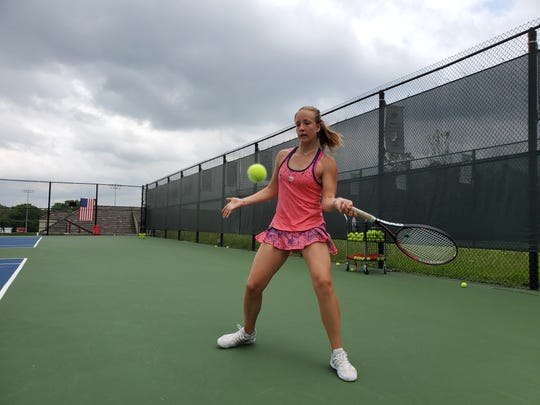 Park Tudor sophomore and foreign exchange student Jule Schulte hits during practice on May 29, 2019.