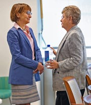 Eskenazi Health CEO Dr. Lisa Harris, left, speaks with Sandy Eskenazi,  Friday, May 24, 2019.  Eskenazi has made a $5 million gift to Eskenazi Health to support mental health services.