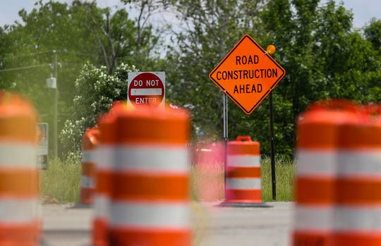 A construction crew completes roadwork at Binford Boulevard and Rucker Road in Indianapolis on Thursday, May 30, 2019. The Binford Boulevard Project is expected to be finished by November 2019.