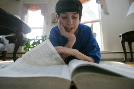 David Tidmarsh, 2004 winner of the National Spelling Bee, thumbs through the dictionary he studied to help him to victory.