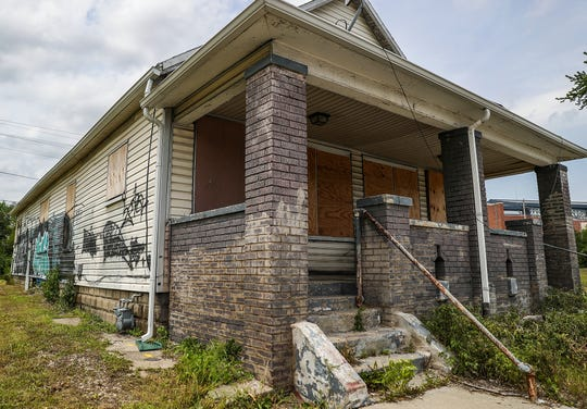 "A house at 942 S. Kenwood Ave. sits vacant in Indianapolis on May 17, 2019. A repair order was issued to the owner, part of Mayor Joe Hogsett's 2000 Homes Initiative, which aims to ""rehab, transform or demolish homes"" in Indianapolis."