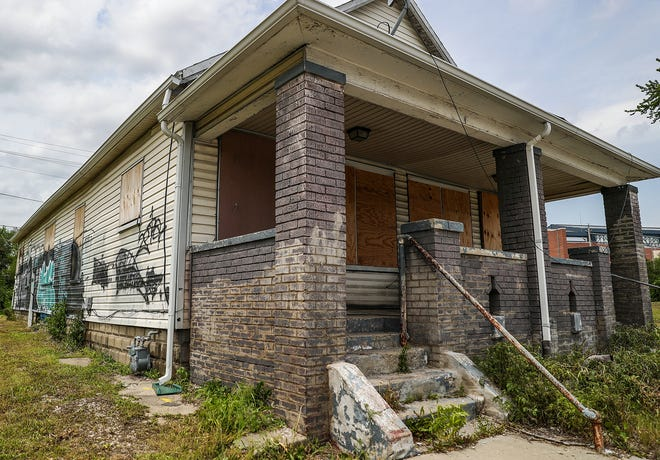"A house at 952 S. Kenwood Ave. sits vacant in Indianapolis on Friday, May 17, 2019. A repair order was issued to the owner, part of Mayor Joe Hogsett's 2000 Homes Initiative, which aims to ""rehab, transform or demolish homes"" in Indianapolis, in an effort to reduce crime. The bulk of the housing interventions on Hogsett's list aren't renovations or demolitions, but repair orders issued by code enforcement officers."