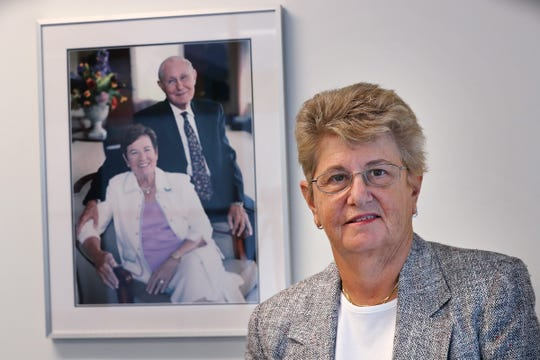A portrait of Lois and Sidney Eskenazi is behind their daughter, Sandy Eskenazi, Friday, May 24, 2019.  Sandra Eskenazi has made a $5 million gift to Eskenazi Health to support mental health services.