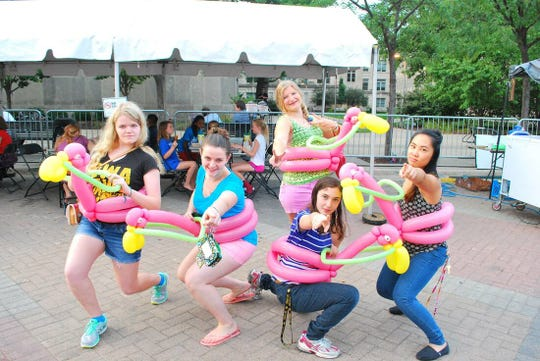 Balloon flamingos made by balloon artist Chad Johnson during Summer of the Arts.