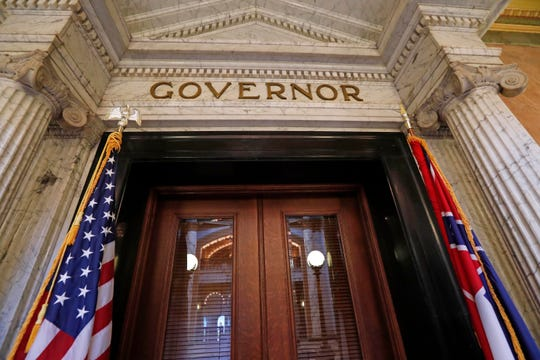 The title of governor rests above the entrance to the office at the Mississippi State Capitol in Jackson, Miss.