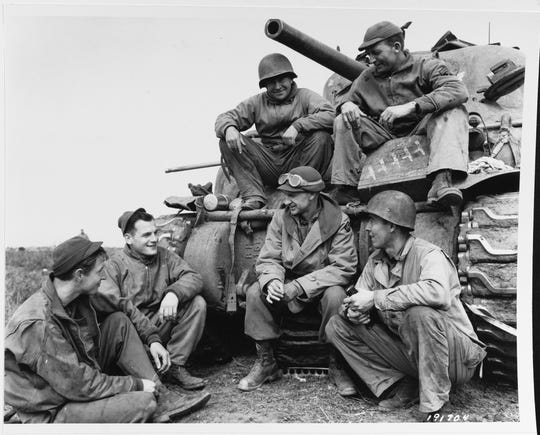 Ernie Pyle visits with a tank crew of the 91st Tank Battalion in the Anzio Beachhead, circa March 1944.