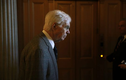 In this Dec. 1, 2017 file photo, U.S. Sen. Thad Cochran (R-MS) leaves the Senate chamber after a vote at the Capitol in Washington, DC. Cochran, 81, died in May. U.S. Navy officials have decided to name a ship after the late senator.