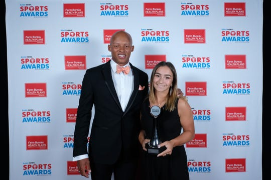 Regan Weekly, of TKA, winner of the Softball Player of the Year Award, poses with Joshua Dobbs at the 2019 Knox News Sports Awards at the Tennessee Theatre in Knoxville, Tennessee on Wednesday, May 29, 2019.