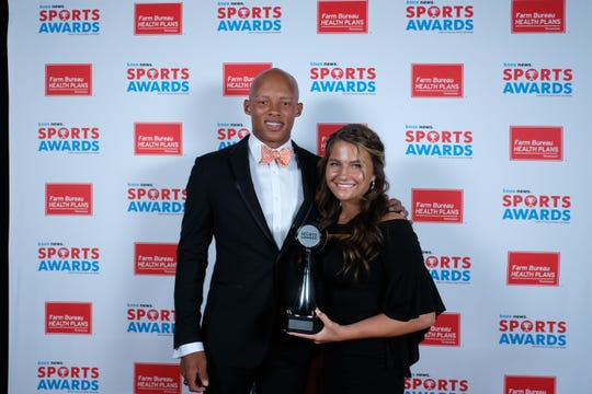 Raelee Scarbrough, winner of the I AM SPORT Award, poses with Joshua Dobbs at the 2019 Knox News Sports Awards at the Tennessee Theatre on May 29, 2019.