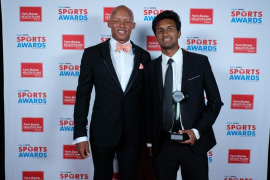 Ohm Sharma, of Webb, winner of the Boys Tennis Player of the Year Award, poses with Joshua Dobbs at the 2019 Knox News Sports Awards at the Tennessee Theatre in Knoxville, Tennessee on Wednesday, May 29, 2019.
