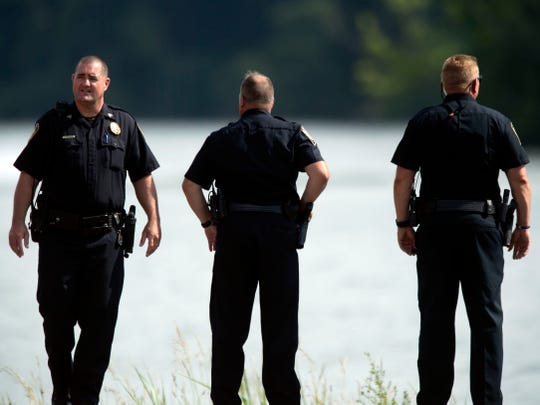 Knox County Sheriff's deputies at Melton Hill Park where the Knoxville Volunteer Emergency Rescue Squad are retrievingthe body of a man who jumped from nearby cliffs into the water and never resurfaced on Thursday, May 30, 2019.