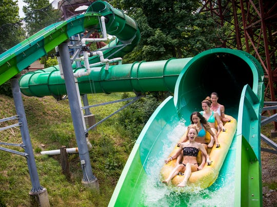 Guests enjoy the RiverRush watercoaster at Dollywood's Splash Country on Thursday, May 30, 2019.
