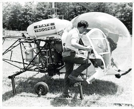 "William Martin boards a state helicopter to test a loudspeaker he hopes to use to ""talk"" his missing son to safety on June 20, 1969 in the Great Smoky Mountains National Park. It was the fourth day of the search for Dennis Martin, 6, who disappeared at Spence Field. (KNOXVILLE NEWS SENTINEL ARCHIVE)"