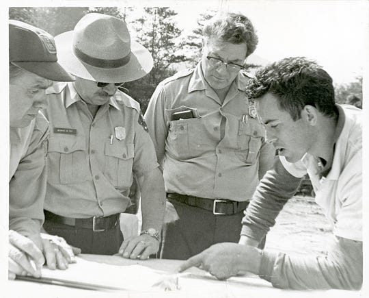 William Martin, right, gives park officials an account of the first hours of the search for his son, Dennis Martin, 6, on June 20, 1969 in the Great Smoky Mountains National Park. Pictured are, from left, unidentified, Park Superintendent George Fry and Chief Ranger Lee Sneddon. (KNOXVILLE NEWS SENTINEL ARCHIVE)