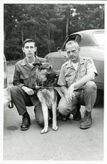 J.W. Eaker, a Spartanburg, S.C., city policeman, his dog, Dante, and Ranger Carl Lamb were among the searchers for Dennis Martin, 6, on June 23, 1969 in the Great Smoky Mountains National Park.