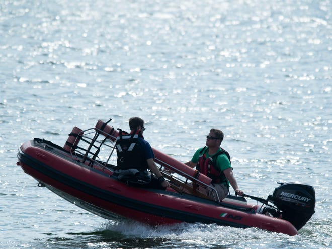 Knoxville Volunteer Emergency Rescue Squad retrieve the body of a man who jumped from nearby cliffs at Melton Hill Park into Melton Hill Lake and never resurfaced on Thursday, May 30, 2019.