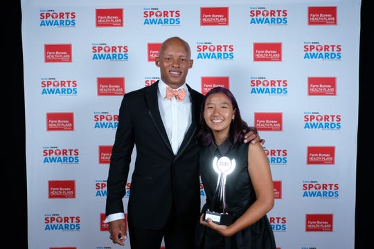 Audrey Yoon, of Webb, winner of the Girls Tennis Player of the Year Award, poses with Joshua Dobbs at the 2019 Knox News Sports Awards at the Tennessee Theatre in Knoxville, Tennessee on Wednesday, May 29, 2019.