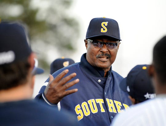 Southern coach Roger Cador speaks to his players prior to their season opener Feb. 15, 2013 in Baton Rouge.