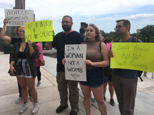 "Abortion rights protesters staged a ""stand-in"" at the State Capitol Thursday in response to Wednesday's final passage of the ""fetal heartbeat"" bill by the Louisiana House that Gov. John Bel Edwards signed."