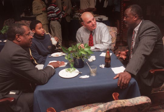 In this Nov. 11, 1998, file photo, San Francisco Giants manager Dusty Baker, Jonathan Cador and LSU baseball coach Skip Bertman listen to Southern baseball coach Roger Cador at the Camelot Club.