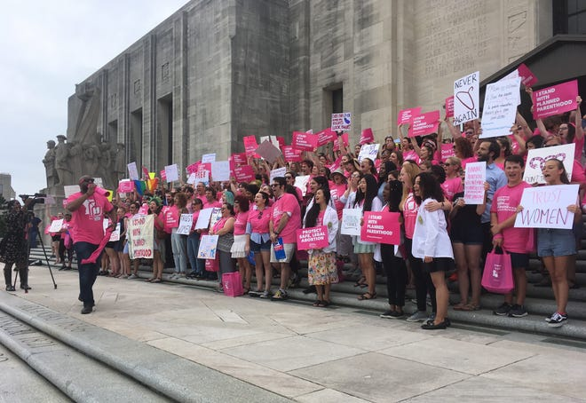 """Abortion rights protesters staged a """"stand-in"""" at the State Capitol Thursday in response to Wednesday's final passage of the """"fetal heartbeat"""" bill by the Louisiana House that Gov. John Bel Edwards signed."""