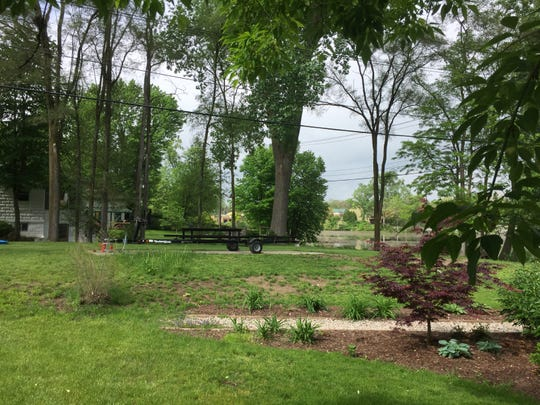 A community garden space and house containing three rental apartments on the Mill Pond in Brighton is slated to be demolished to make way for an eight townhouses. The First Street property is shown Wednesday, May 29, 2019.