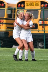 Brighton's Bryce Calka (left) celebrates with Brooke Pietila after scoring the winning goal in a 1-0 victory over Northville in a district semifinal at Novi on Wednesday, May 29, 2019.