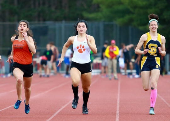 Brighton's Felesity Norris (center) qualified for the state meet in the 100-meter dash and two relays.