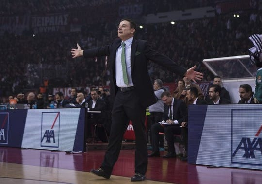 Rick Pitino gestures to his Panathinaikos team during a January 2019 game in Greece.