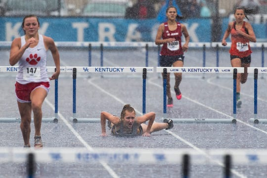 University Heights' Evelyn Morales reacts after tripping over a hurdle during the 300 meter hurdles event at the KHSAA Class 1A Track State Championships in Lexington, Kentucky. May 30, 2019