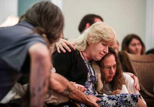 Jacqueline Risner and Crystal Johnson hold each other during the funeral service for Risner's daughter Christina Coy and Johnson's brother Douglas Borders at the Springs Valley Funeral Home in New Albany. Borders and longtime love Coy were killed last week after their truck was rear ended by one vehicle before colliding with another truck on I-265 in New Albany.