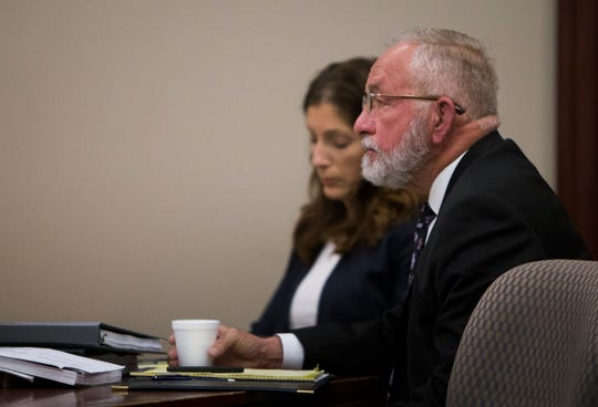 William Strampel, right, former Dean at the College of Osteopathic Medicine at Michigan State University sits with attorney Maria Dwyer, Thursday, May 30, 2019, in Joyce Draganchuk's Ingham County courtroom.