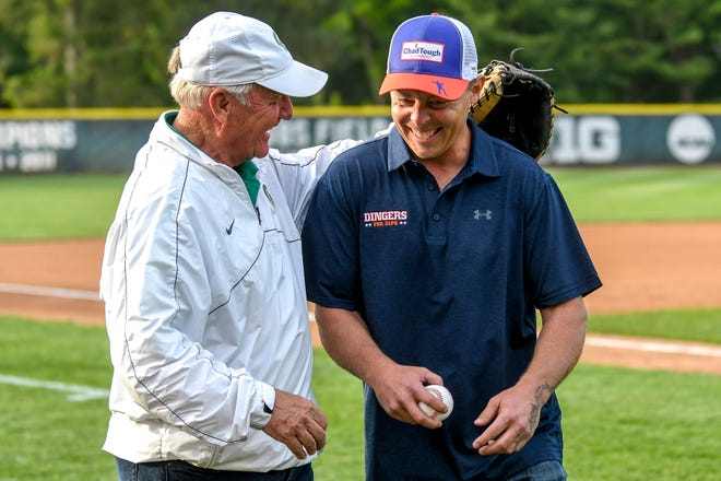 Former Detroit Tiger Brandon Inge, right, laughs with Jake Boss Sr. before the Williamston vs. Mason game on Wednesday, May 29, 2019, at McLane Stadium on the Michigan State University campus in East Lansing. Inge threw out the first pitch and Boss caught for him.
