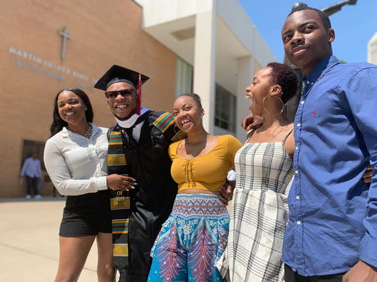 Elie Kirkland, second from left, is among 400 Morehouse College grads graduating with zero debt thanks to billionaire Robert Smith. His siblings, Keshava, Nyla, Cherished and A.J. joined him for his May 19, 2019 graduation.