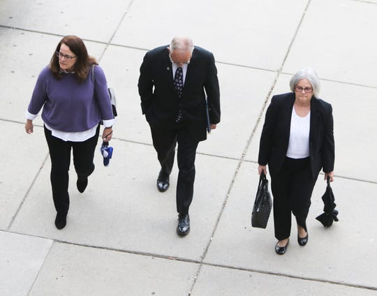 William Strampel former dean at the College of Osteopathic Medicine at Michigan State University heads into Veterans Memorial Courthouse in Lansing, Thursday, May 30, 2019, for the first day of his trial hearing.  He faces charges of sexual assault and misconduct in office.