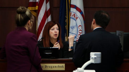 Circuit Court Judge Joyce Draganchuk confers with the Assistant AG Daniellle Hagaman-Clark, left, and John Dakmak, an attorney representing William Strampel, the former dean of the College of Osteopathic Medicine at MSU, Thursday, May 30, 2019.