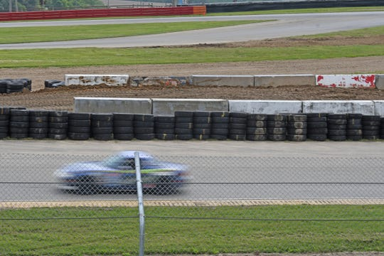An SCCA driver passes the new rally car ramp in the Keyhole turn at the Mid-Ohio Sports Car Course on Thursday afternoon.