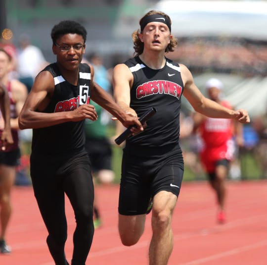 Crestview anchor James Barber takes the baton from Garett Dudley as the Cougars earn a fourth place medal in the 4x400 relay at last year's state meet.