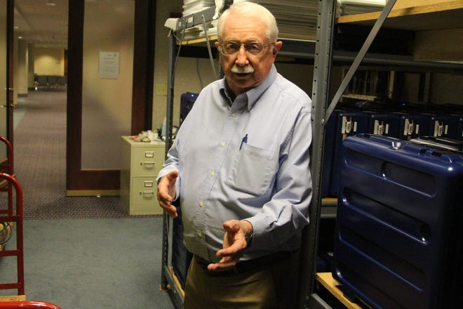Ed Shafer, 78, stands next to voting equipment stored in the basement of the Marion County Building on West Center Street. He has been involved with every Marion County election for nearly 30 years. He retired as a part-time employee of the Marion County Board of Elections last Friday.