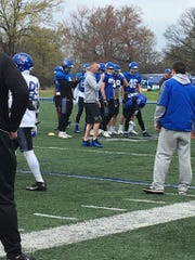 Memphis football coach Mike Norvell wore Penny Hardaway's famous blue shoes to practice March 20, 2018, the day Hardaway was introduced as the men's basketball coach.