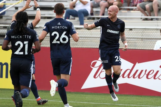 Memphis 901 FC's Jochen Graf, right, celebrates his goal with teammtes during their match against Hartford Athletic in the U.S. Open Cup at the Mike Rose Soccer Complex on Wednesday.