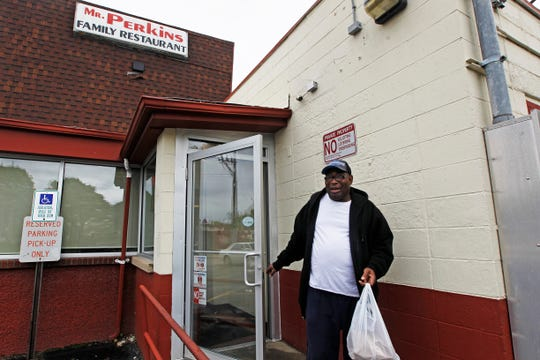 Jack Sanders, 59 of Milwaukee, leaves Mr. Perkins Family Restaurant on Thursday with his order of smothered pork chops.  Sanders has been coming to the restaurant for over 25 years.
