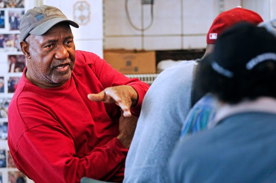 """Jerry Smith, 69, talks with regulars at Mr. Perkins Family Restaurant on Wednesday. Smith has been dining at the restaurant for all of its 50 years. """"They've been like a family to me. They know how to respect the customers,"""" he said."""