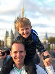 Carson poses on his dad's shoulders at Disney World this March. Carson was diagnosed with Type 1 diabetes at 13 months old.