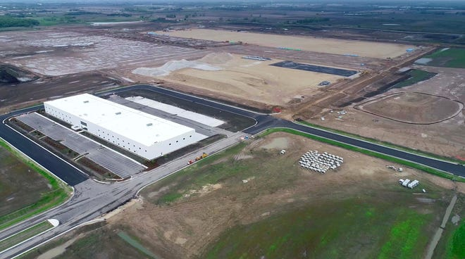 "A front view of the first initial structure on the Foxconn construction site, a 120,000-square-foot ""multi-purpose building,"" is seen at Foxconn Technology Group's planned flat-screen manufacturing complex under construction in Mount Pleasant/"